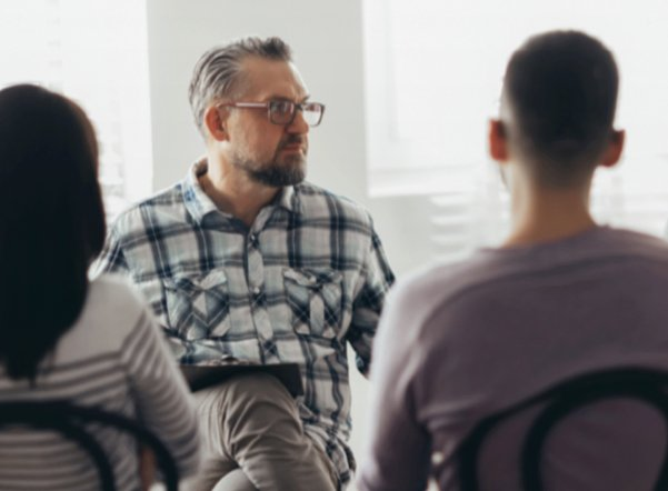 man leading counseling session