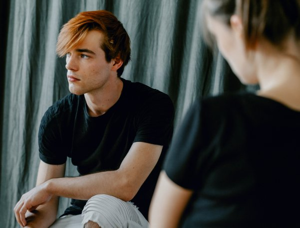 young adult man at a counseling session